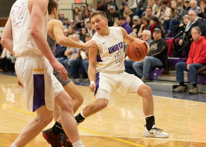 Unioto's Isaac Little dribbles the ball along the perimeter during a 61-30 win over Westfall on Friday, Feb. 14, 2020. Zane Trace and Unioto share the SVC championship title.