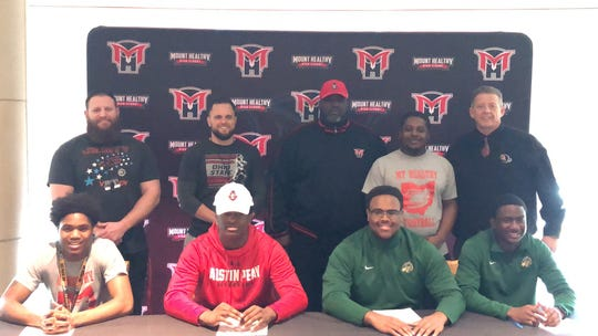 Mt. Healthy football players signed their letters of intent to play football in college Feb. 5. They are: Danarius Shaw, Dupage; Brandon Lanier, Austin Peay; Cortez Huckleby, Tiffin; and Alasanne Diallo, Tiffin