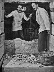 Howard Carter (left) and Lord Carnarvon breaking into King Tutankhamun's tomb, 1923.