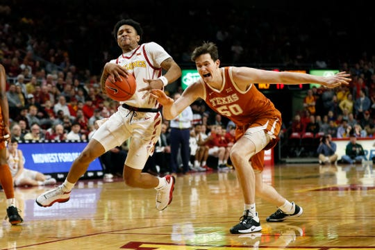 Iowa State guard Prentiss Nixon drives past Texas center Will Baker, right, during the first half of an NCAA college basketball game, Saturday, Feb. 15, 2020, in Ames, Iowa.