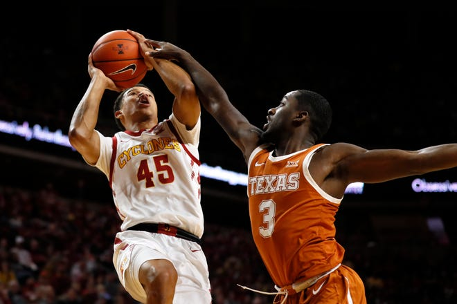 Iowa State guard Rasir Bolton (45) is fouled by Texas guard Courtney Ramey (3) while driving to the basket during the first half of an NCAA college basketball game, Saturday, Feb. 15, 2020, in Ames, Iowa.