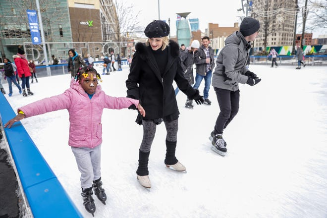 American figure skating champion JoJo Starbuck takes Serenity King, 7, of Detroit around the ice rink at Campus Martius Park in downtown Detroit on Saturday. Starbuck and children of incarcerated or formerly incarcerated parents spent the day at the Angel Tree Sports Clinic that was organized by Prison Fellowship, the nation's largest Christian nonprofit serving prisoners, former prisoners, and their families.