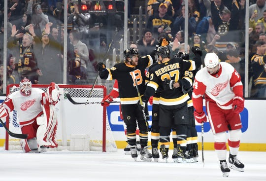 Boston Bruins celebrate a goal during the second period against the Detroit Red Wings in Boston, Saturday, Feb. 15, 2020.