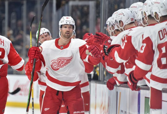 Detroit Red Wings left wing Darren Helm celebrates with teammates after scoring a goal during the first period against the Boston Bruins in Boston, Saturday, Feb. 15, 2020.
