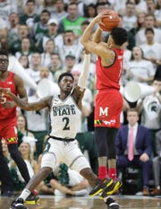 Michigan State guard Rocket Watts defends Maryland guard Anthony Cowan Jr. during the first half Saturday, Feb. 15, 2020 at the Breslin Center.
