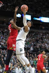 Michigan State's Xavier Tillman scores against Maryland's Jalen Smith during the first half Saturday, Feb. 15, 2020 at the Breslin Center.
