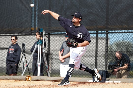 Pitcher Zack Godley makes a throw during Detroit Tigers spring training at TigerTown in Lakeland, Fla., Saturday, Feb. 15, 2020.