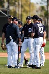 Ron Gardenhire talks to pitchers Matthew Boyd, Spencer Turnbull and Tarik Skubal during spring training Saturday in Lakeland, Fla.