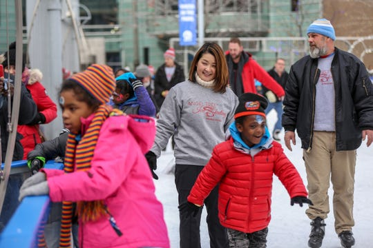 1994 World Champion and Olympian Yuka Sato skates with children at the Campus Martius Park ice rink in downtown Detroit on Saturday.