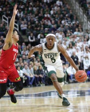 Cassius Winston drives against Anthony Cowan Jr. on Feb. 15.