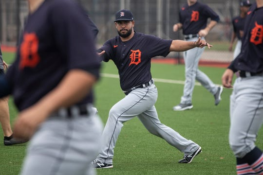 Pitcher Wladimir Pinto, center, warms up during Detroit Tigers spring training at TigerTown in Lakeland, Fla., on Friday, Feb. 14, 2020.