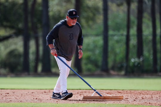 Manager Ron Gardenhire rakes infield dirt at practice during Detroit Tigers spring training at TigerTown in Lakeland, Fla., Saturday, Feb. 15, 2020.