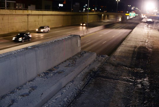 A portion of the top half of the retaining wall on the Lodge Service Drive fell on the southbound Lodge Freeway on Friday night, the Michigan Transportation Department and Michigan State Police said.