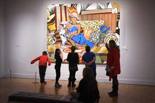 Visitors look at Something You Can Feel by artist Mickalene Thomas at the Detroit Institute of Arts on Friday, February 14, 2020. The DIA is requesting that voters pass a 0.2-mill increased millage in the March 10th election.