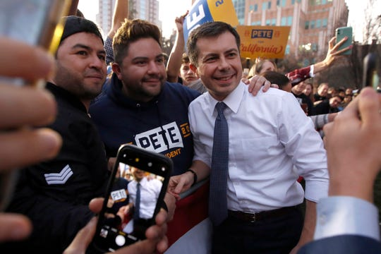 Democratic presidential candidate and former South Bend Mayor Pete Buttigieg poses for photos with supporters during a town hall rally in Sacramento, Calif., Friday, Feb. 14, 2020.