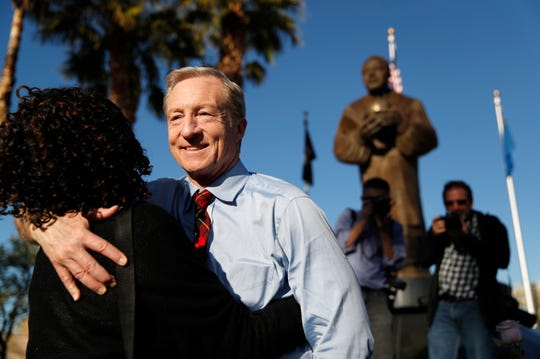 Democratic presidential candidate businessman Tom Steyer embraces a supporter at the Martin Luther King Jr. Senior Center, Friday, Feb. 14, 2020, in Las Vegas.