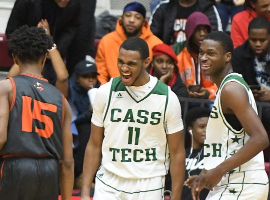 Cass Tech's Tyson Acuff lets out a yell after battling and scoring a basket in the second half.
