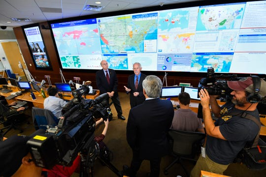 Jay Butler, Deputy Director for Infectious Diseases addresses the media about response to the 2019 Novel Coronavirusas as Senior Advisor Ed Rouse looks on, at the Emergency Operations Center inside The Centers for Disease Control and Prevention (CDC), Thursday, Feb. 13, 2020, in Atlanta.