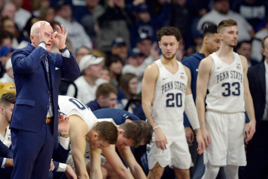 Penn State coach Patrick Chambers gives a signal from the bench.