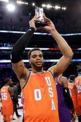 U.S. forward Miles Bridges, of the Charlotte Hornets, holds the MVP trophy after the NBA Rising Stars basketball game Friday in Chicago.