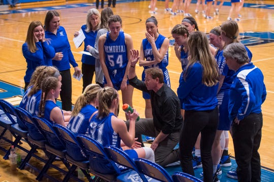 Memorial Head Coach Lee Auker during a timeout as the Memorial Lady Tigers play the Greensburg Lady Pirates during the IHSAA Class 3A girls basketball regional tournament at Charlestown High School in Charlestown, Ind., Saturday morning, Feb. 15, 2020.