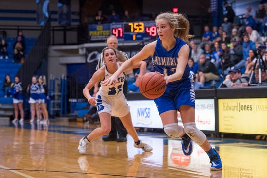 Memorial's Peyton Murphy (12) drives the ball as the Memorial Lady Tigers play the Greensburg Lady Pirates during the IHSAA Class 3A girls basketball regional tournament at Charlestown High School in Charlestown, Ind., Saturday morning, Feb. 15, 2020.