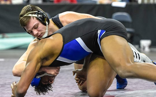 Castle's Robert Deters wrestles Franklin Community's Jalen Ward in the 170 class in a semifinal match during the Evansville Wrestling Semi state held at the Ford Center Saturday, February 15, 2020.