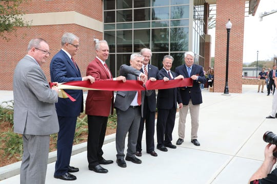 President John Thrasher, along with other faculty members including Dr. Eric Barron cut the ribbon on the new Earth, Ocean and Atmospheric Science building.