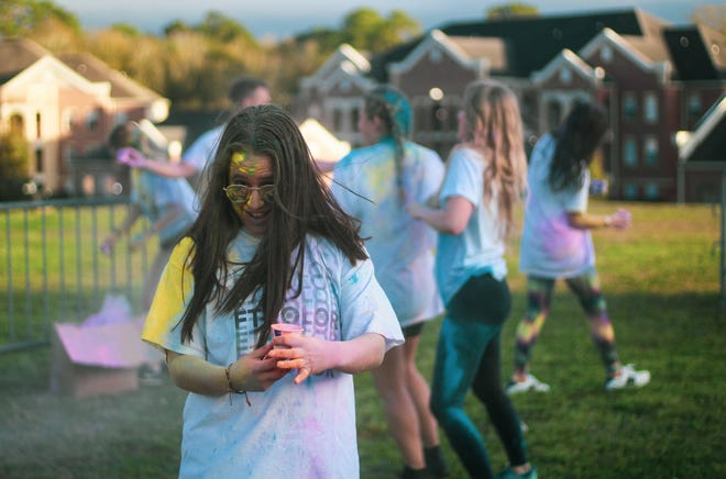 Students participating in the FTKolor event, sponsored by DMFSU, were covered in paint powder.