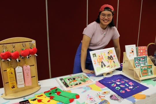 Jennifer Xiao presenting her illustrations turned into merchandise before her presentation.