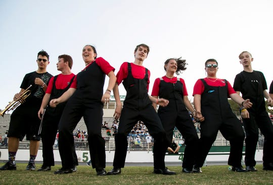 North Fort Myers High School band members dance while waiting for the start of the 2020 Edison Festival of Light Grand Parade on Saturday, Feb. 15, 2020.