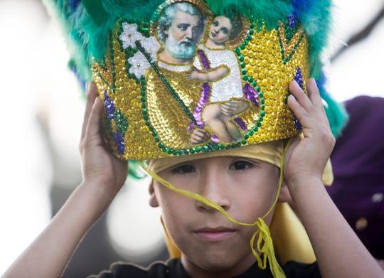 Alex Yata, 7, gets ready for the 2020 Edison Festival of Light Grand Parade on Saturday, Feb. 15, 2020.