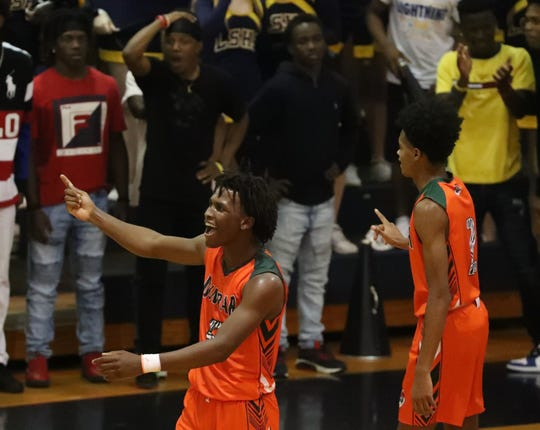 Dunbar's Shawn Bonamy and Ahmad Watkins celebrate a big block late in the game to help secure their lead.  Dunbar beat Lehigh 68-64 in their boys basketball District 6A-12 championship game at Lehigh.