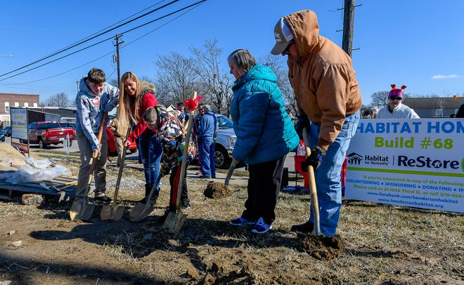 Jayden Sauer, 13, mom Katie Sauer, and Kegan Sauer, 9, officially break ground along with Janice and Dennis Wiles on two new Habitat for Humanity homes, which will be located at 217 and 219 Letcher Street. The double groundbreaking ceremony for the Wiles and Sauer families was held on Valentines Day at noon in the Henderson's East End.