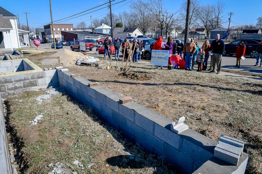 People gather at 217 and 219 Letcher Street for a Valentine's Day Habitat for Humanity of Henderson groundbreaking for two homes in the city's East End Friday, February 14, 2020.