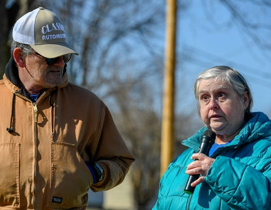 Future homeowners Janice Wiles, with her husband Dennis, speaks during Friday's Habitat ceremony.