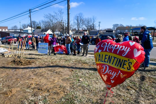 A balloon floats over people gathering at 217 and 219 Letcher Street for a Valentine's Day Habitat for Humanity of Henderson groundbreaking for two homes in the city's East End Friday, February 14, 2020.