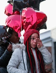 Andrie Steen wipes tears from her eyes during a community prayer vigil for her relative Marcel Wills on Friday, Feb. 14, 2020.