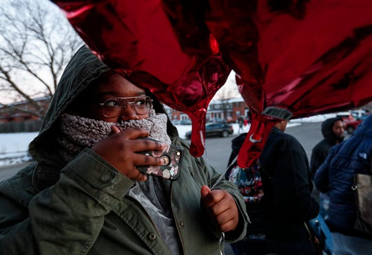 Johnnetta Lewis, 15, holds balloons during community prayer vigil for her cousin, Jalen Roberts, on Friday, Feb. 14, 2020. Roberts was one of four found shot dead inside his apartment in the Carriage House East complex late on the night of Feb. 5. At 19, he was the youngest slain: Marcel Wills, 20; Braxton Ford, 21; and Kimari Hunt, 21, were also pronounced dead at the scene.