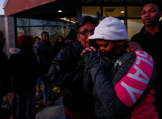 Kimberly Roberts is comforted during a community prayer vigil for her son, Jalen Roberts, on Friday, Feb. 14, 2020. Roberts was one of four found shot dead inside his apartment in the Carriage House East complex late on the night of Feb. 5. At 19, he was the youngest slain: Marcel Wills, 20; Braxton Ford, 21; and Kimari Hunt, 21, were also pronounced dead at the scene.