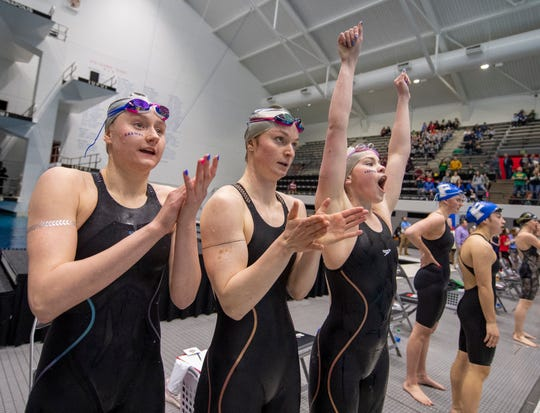 Carmel High School's Girls 200 Yard Freestyle Relay team members, from left, Avery Williams, Colleen Duffy, and Gretchen Lueking react after winning the event during the IHSAA 2019-20 Girls Swimming & Diving State Tournament, Saturday, Feb. 15, 2020, at IU Natatorium in Indianapolis.