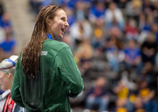 Devon Kitchel of Zionsville High School reacts towards the cheers of her fans after winning the Girls 200 Yard IM event during the IHSAA 2019-20 Girls' Swimming & Diving State Tournament, Saturday, Feb. 15, 2020, at IU Natatorium in Indianapolis.