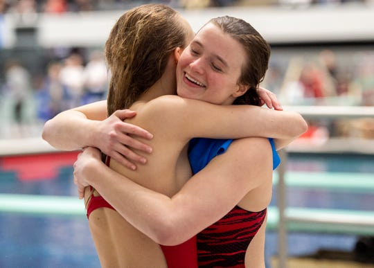 Morgan Casey, right, of Fishers High School reacts after winning the Girls 1 Meter Diving event during the IHSAA 2019-20 Girls Swimming & Diving State Tournament, Saturday, Feb. 15, 2020, at IU Natatorium in Indianapolis.