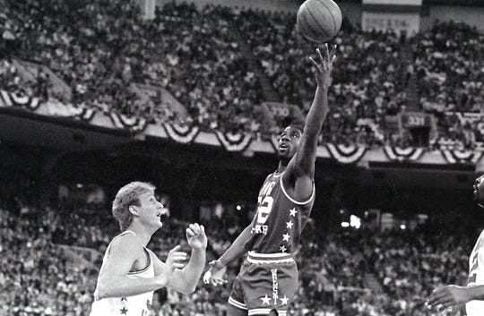 Magic Johnson shoots over Larry Bird in the NBA All-Star game at the Hoosier Dome, Feb. 9, 1985