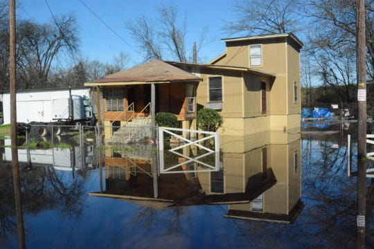 Floodwaters reach a home on Factory Street in Jackson south of downtown on Saturday, Feb. 15, 2020.