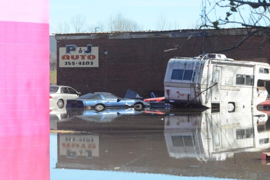 Several vehicles in the parking lot of P&J Auto on S. West Street in Jackson are consumed by floodwaters on Saturday, Feb. 15, 2020.