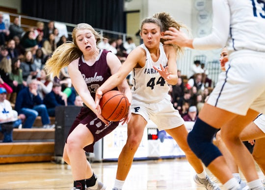 Farragut's Ashlyn Sheridan (44) and Bearden's Emma Stone (33) fight for the ball during a game Feb. 14.