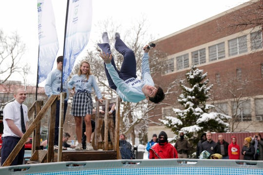 Lincoln Gaeta takes a back flip into the pool during the 2020 Special Olympics Polar Plunge at Purdue University's Lambert Fieldhouse, Saturday, Feb. 15, 2020 in West Lafayette. Gaeta took the pluge for the Ice Kold Knights from Central Catholic High School.