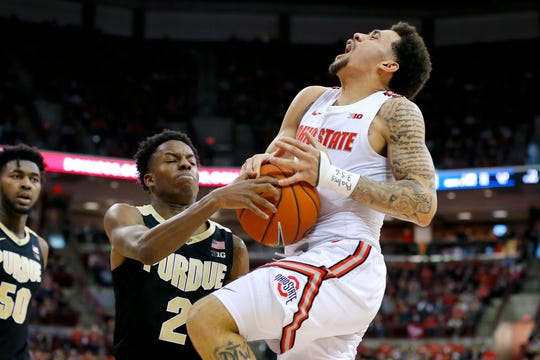 Feb 15, 2020; Columbus, Ohio, USA; Ohio State Buckeyes guard Duane Washington Jr. (4) is fouled by Purdue Boilermakers guard Eric Hunter Jr. (2) during the second half at Value City Arena. Mandatory Credit: Joseph Maiorana-USA TODAY Sports