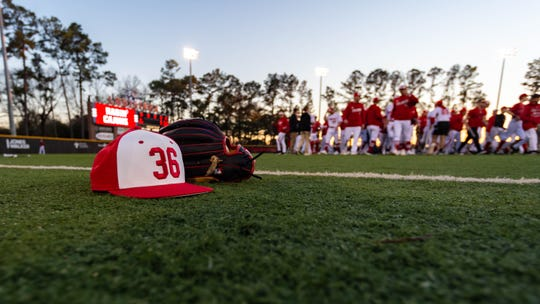 A cap honoring former coach Tony Robichaux, who wore the number 36, is shown before the Cajuns' 2020 season opener.